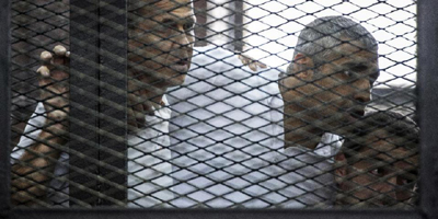 Egypt court orders retrial of jailed Jazeera reporters