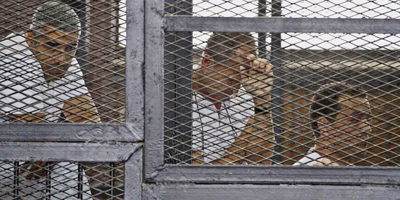 Egypt sentences three Al-Jazeera journalists to seven years in prison
