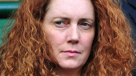 Eight charged in phone hacking scandal