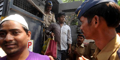 Indian court convicts four for raping photojournalist