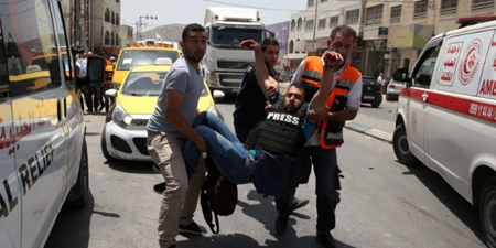 Photojournalist wounded in West Bank