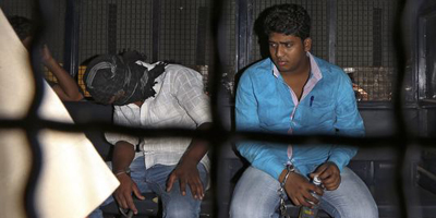 Three sentenced to death for journalist's gang rape in India