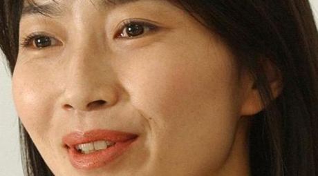 Body of slain Japanese journalist returns home