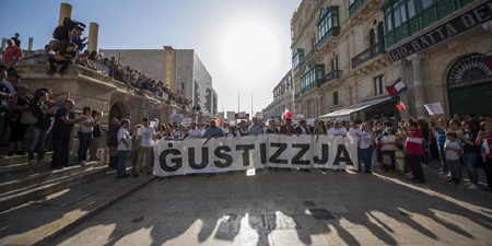 Malta newspapers, citizens take up slain reporter's message