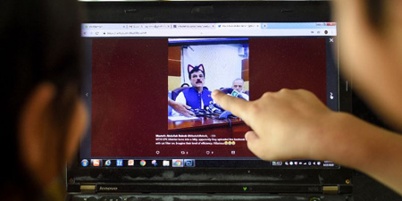 Minister's presser live streamed with cat whiskers, ears